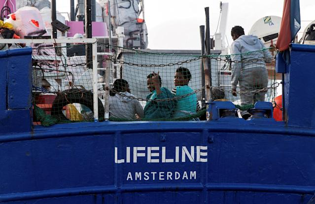 Migrants are seen on the deck of the Mission Lifeline rescue boat in the central Mediterranean Sea, June 21, 2018. Picture taken June 21, 2018. Hermine Poschmann/Misson-Lifeline/Handout via REUTERS ATTENTION EDITORS - THIS IMAGE WAS PROVIDED BY A THIRD PARTY. NO RESALES. NO ARCHIVES TPX IMAGES OF THE DAY