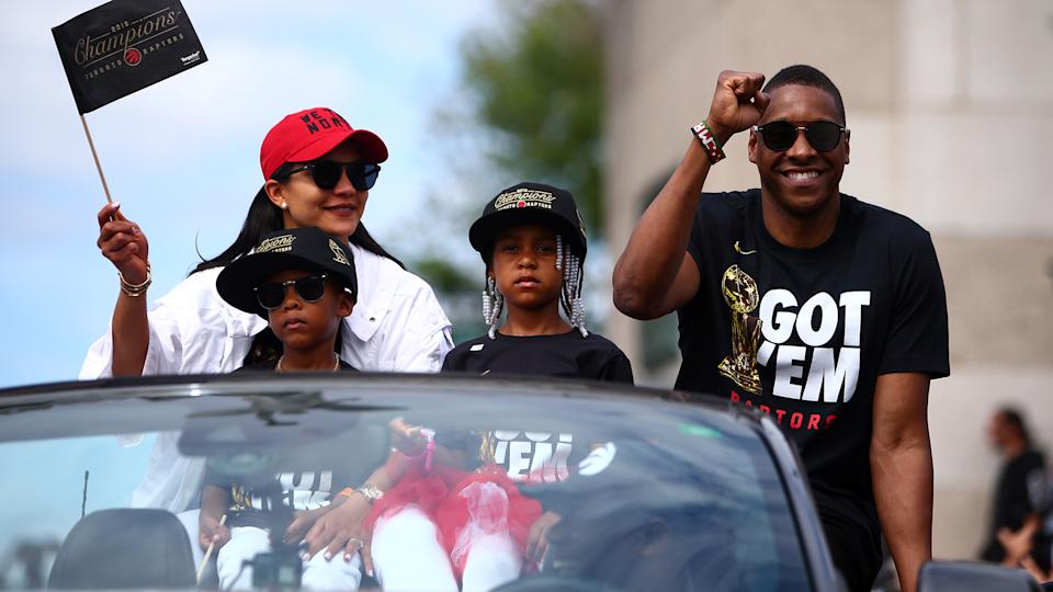 TORONTO, ON - JUNE 17:  Toronto Raptors President Masai Ujiri and family wave to the crowd during the Toronto Raptors Victory Parade on June 17, 2019 in Toronto, Canada. The Toronto Raptors beat the Golden State Warriors 4-2 to win the 2019 NBA Finals.  NOTE TO USER: User expressly acknowledges and agrees that, by downloading and or using this photograph, User is consenting to the terms and conditions of the Getty Images License Agreement.  (Photo by Vaughn Ridley/Getty Images)