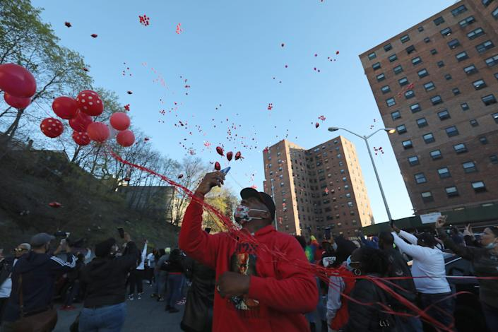 Balloons are released during a a vigil for DMX where he grew up, on School Street in Yonkers April 13, 2021.
