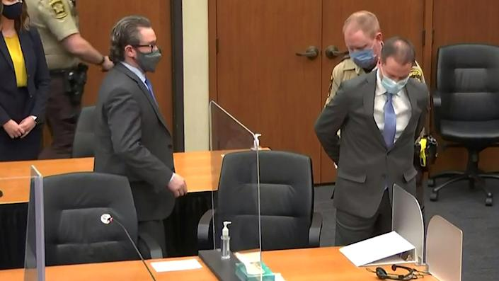 Former Minneapolis police officer Derek Chauvin is handcuffed to be led away after a jury found him guilty of all charges in his trial for second-degree murder, third-degree murder and second-degree manslaughter in the death of George Floyd in Minneapolis, Minnesota, U.S. April 20, 2021 in a still image from video.  (Pool via Reuters)