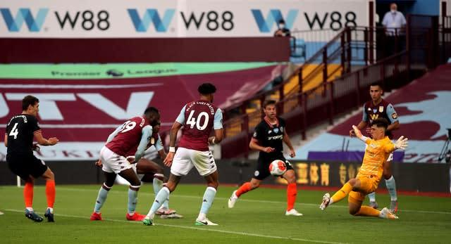 Kortney Hause (centre background partially obscured) opens the scoring for Aston Villa against Chelsea (Molly Darlington/NMC Pool)