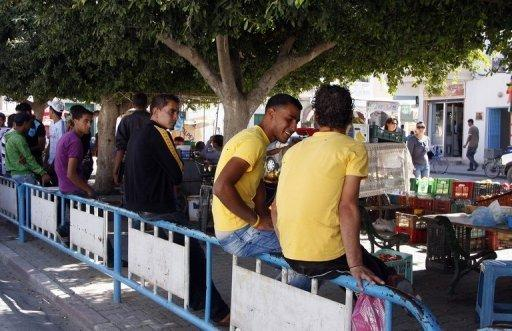 Unemployed youth hang out in Tunisia in 2011. The ILO said nearly 75 million youths or 12.7 percent of people aged 15 to 24 will be out of work this year, up from 12.6 percent in 2011