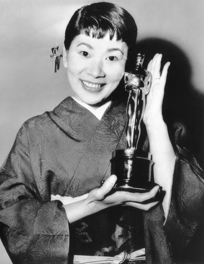 "FILE - Japanese actress Miyoshi Umeki, poses with her Academy Award for best supporting actress for her role in ""Sayonara,"" during the Academy Awards ceremony in Los Angeles on March 26, 1958. Umeki was the first person from Japan to win an Oscar. (AP Photo)"