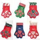 """<p>Delightful paw-shaped stockings handmade with co-ordinating gingham lining, embroidered with your pet's name.<br></p><p>£13.75 <a href=""""https://www.etsy.com/uk/listing/250009073/pet-animal-cat-dog-paw-christmas?ga_order=most_relevant&ga_search_type=all&ga_view_type=gallery&ga_search_query=pet&ref=sr_gallery_7"""" rel=""""nofollow noopener"""" target=""""_blank"""" data-ylk=""""slk:Emma Crafty Monkey"""" class=""""link rapid-noclick-resp"""">Emma Crafty Monkey</a></p>"""