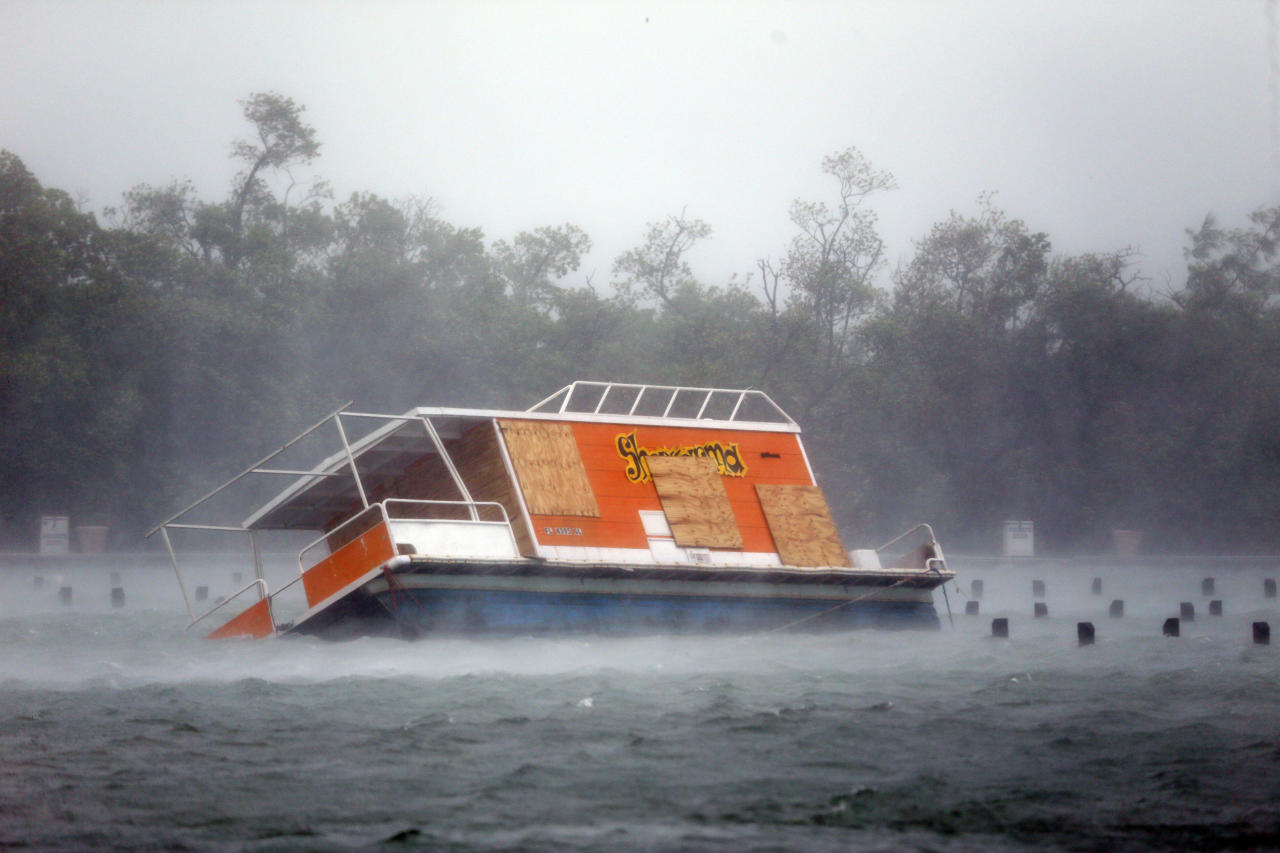 <p></p><p>A floundered boat is shown at the Haulover Marine Center.The 'monster' storm was downgraded from category three to one on Monday morning but still has maximum sustained winds of 85mph.(AP Photo/Wilfredo Lee) </p><p></p>