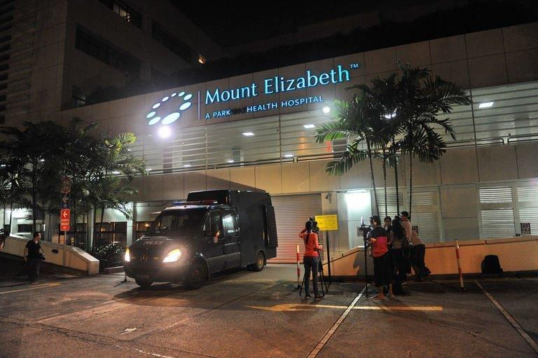 A police morgue vehicle is parked in front of the Mount Elizabeth hospital in Singapore on December 29, 2012