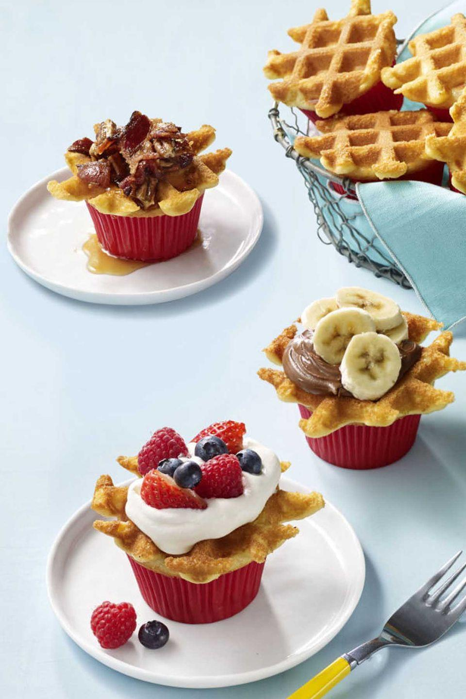 """<p>Who said waffles can't be snacks? These tiny waffle-cupcake hybrids can be topped with any fruit you have in the fridge and yogurt for a healthy snack.</p><p><em><a href=""""https://www.womansday.com/food-recipes/food-drinks/recipes/a57925/wafflecakes-recipe/"""" rel=""""nofollow noopener"""" target=""""_blank"""" data-ylk=""""slk:Get the Wafflecakes recipe."""" class=""""link rapid-noclick-resp"""">Get the Wafflecakes recipe.</a></em></p>"""