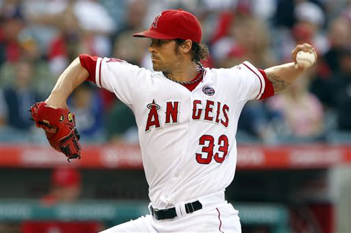 Los Angeles Angels starting pitcher C.J. Wilson delivers against the Oakland Athletics in the first inning during a baseball game on Saturday, July 20, 2013, in Anaheim, Calif. (AP Photo/Alex Gallardo)