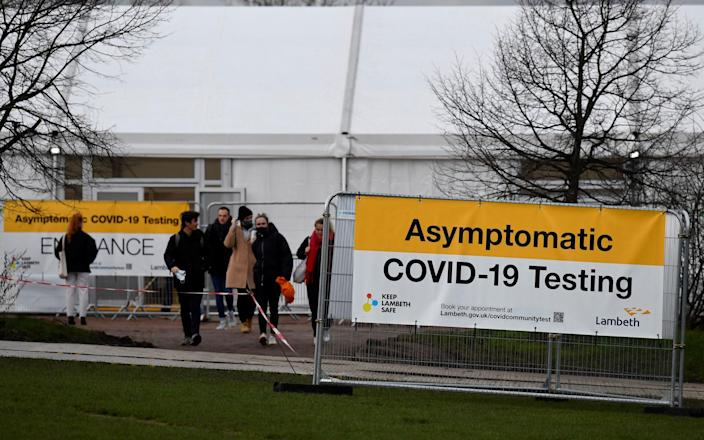 People wait for Covid tests in London amid rising virus cases earlier this month - Toby Melville/Reuters