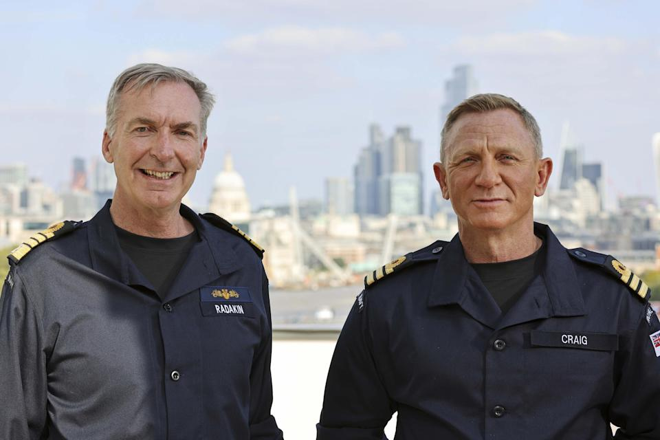 Daniel Craig, wearing the honorary Royal Navy rank of commander, with First Sea Lord Admiral Sir Tony Radakin, left (LPhot Lee Blease/PA)
