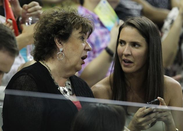 SHANGHAI, CHINA - JULY 27:  Michael Phelps' mother Debbie and sister Hilary talk after he won gold for the United States in the Men's 200m Butterfly Final during Day Twelve of the 14th FINA World Championships at the Oriental Sports Center on July 27, 2011 in Shanghai, China.  (Photo by Ezra Shaw/Getty Images)