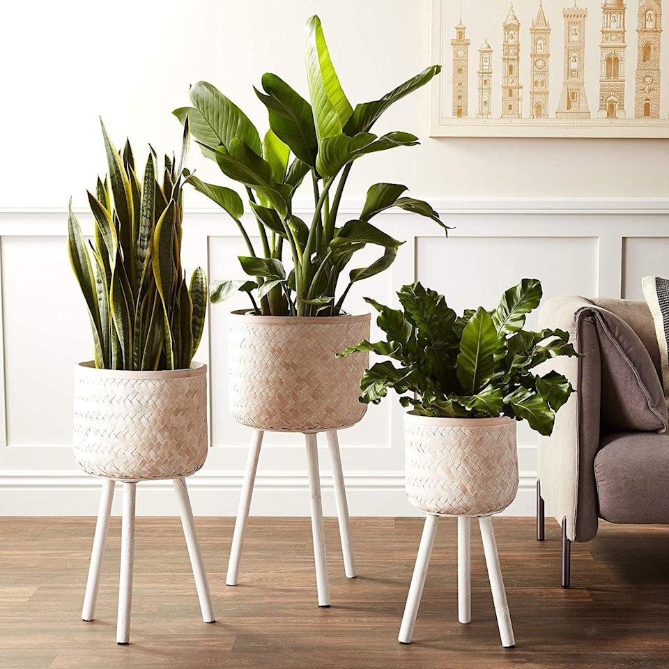 <p>The <span>Bloomingville Round Bamboo Floor Baskets with Wood Legs</span> ($130 for three) is a great way to fill up those awkward corners and accent your space. The bamboo texture will add a natural element to your decor. </p>