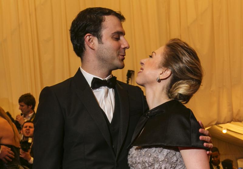 File of Chelsea Clinton arriving with husband Marc Mezvinsky at the Metropolitan Museum of Art Costume Institute Benefit in New York