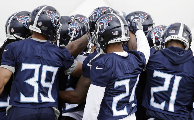 Tennessee Titans players wear their new helmets during a voluntary practice at its NFL football training facility Wednesday, April 25, 2018, in Nashville, Tenn. (AP Photo/Mark Humphrey)