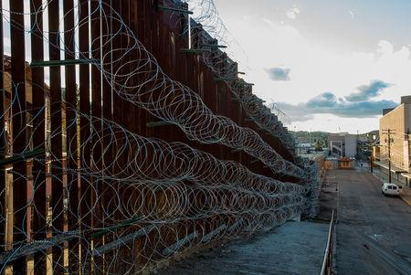 New strands of concertina welded by U.S. Army engineers to the fence that separates the U.S. and Mexico are shown in downtown Nogales