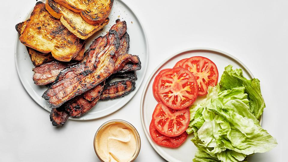 """The only thing that could possibly take summer's best sandwich up a notch? The grill. <a href=""""https://www.epicurious.com/recipes/food/views/grilled-bacon-blt-sandwich?mbid=synd_yahoo_rss"""" rel=""""nofollow noopener"""" target=""""_blank"""" data-ylk=""""slk:See recipe."""" class=""""link rapid-noclick-resp"""">See recipe.</a>"""
