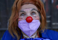 Performer Dionisia Valle, 82, dressed as a clown, poses for a photo during the National Circus Day celebration in Santiago, Chile, Saturday, Sept. 4, 2021, amid the new coronavirus pandemic. Chile's Culture Minister set the stage for the first circus performances with a ringside public since the beginning of the pandemic quarantine measures as the South American country looks to fully roll back almost all COVID-19 related restrictions (AP Photo/Esteban Felix)