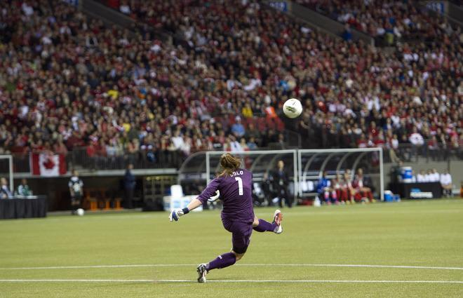 Goalie Hope Solo #1 of the United States kicks the ball back into play during first half of championship action against Canada at the 2012 CONCACAF Women's Olympic Qualifying Tournament at BC Place on January 29, 2012 in Vancouver, British Columbia, Canada. (Photo by Rich Lam/Getty Images)