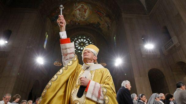 In this Sunday, April 24, 2011 file photo, Cardinal Donald Wuerl, Archbishop of Washington, sprinkles Holy Water during Easter Mass at the Basilica of the National Shrine of the Immaculate Conception Roman Catholic Church in Washington.  (AP)
