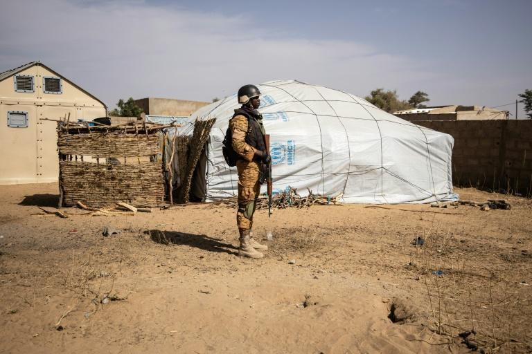 A Burkina Faso soldier patrols at a camp in Dori sheltering people displaced from northern Burkina Faso