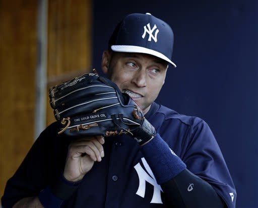 New York Yankees shortstop Derek Jeter (2) adjusts the laces on his glove before a spring training baseball game against the Philadelphia Phillies in Tampa, Fla., Wednesday, March 13, 2013. (AP Photo/Kathy Willens)