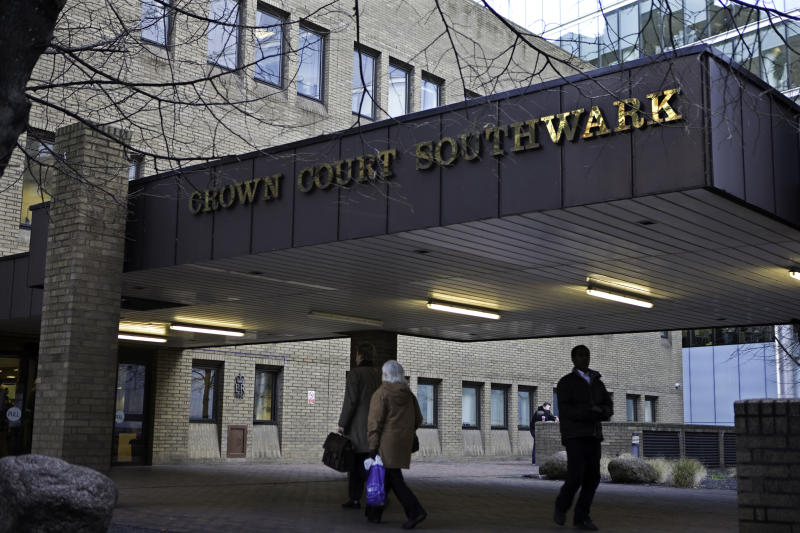 Members of the public arriving at Southwark Crown Court. (Photo by In Pictures Ltd./Corbis via Getty Images)
