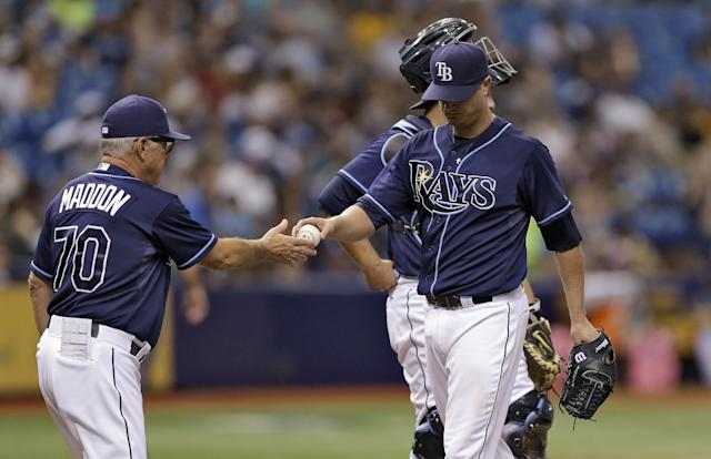 Tampa Bay Rays manager Joe Maddon, left, takes the ball from pitcher Alex Cobb during the fifth inning of a baseball game against the Seattle Mariners Saturday, June 7, 2014, in St. Petersburg, Fla. (AP Photo/Chris O'Meara)