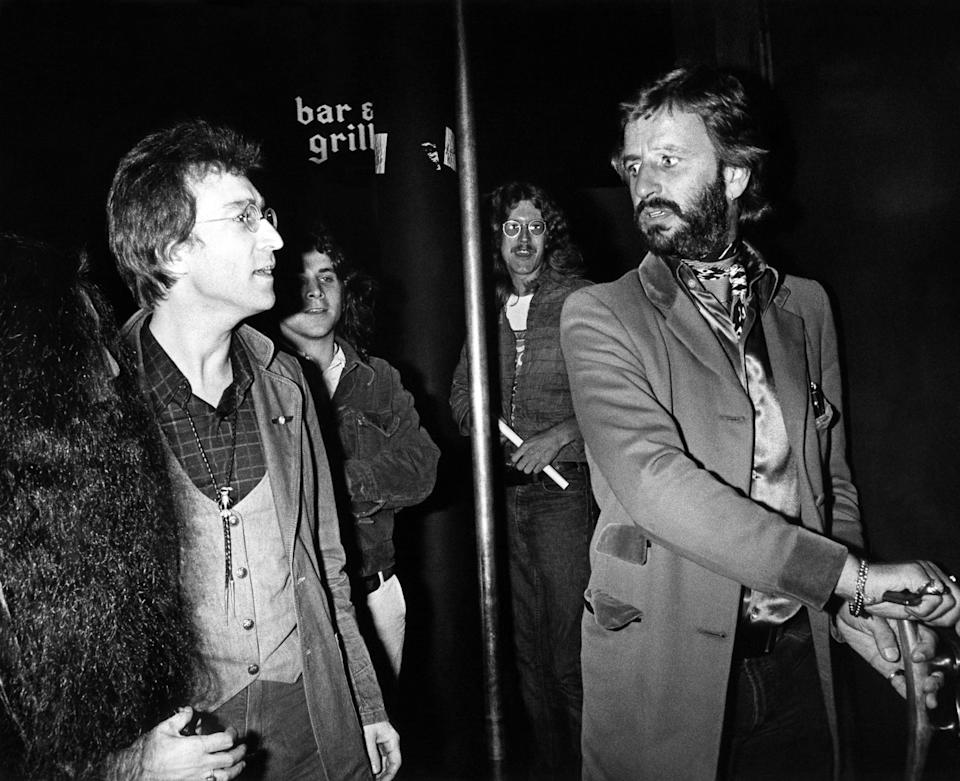 (EXCLUSIVE, Premium Rates Apply) LOS ANGELES - JANUARY 01, 1975: Yoko Ono, John Lennon and Ringo Star arrive at On The Rox nightclub in Los Angeles, California. **EXCLUSIVE** (Photos by Brad Elterman/FilmMagic)