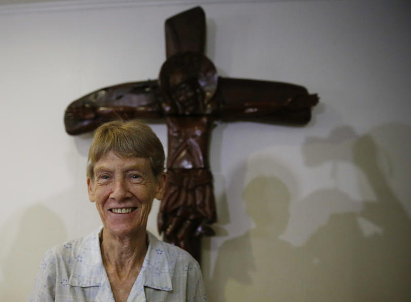 Australian Roman Catholic nun Sister Patricia Fox poses for photographers following a news conference Thursday, April 26, 2018 in suburban Quezon city, northeast of Manila, Philippines. The Australian nun whose missionary visa in the Philippines was revoked after the president complained about her joining opposition rallies said Thursday that social advocacy and human rights are part of church teachings. (AP Photo/Bullit Marquez)