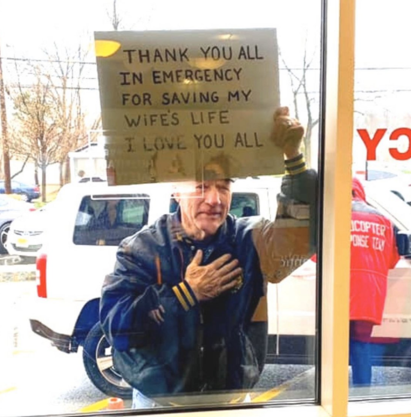 The man is seen holding the sign through the window. Source: Allison S.