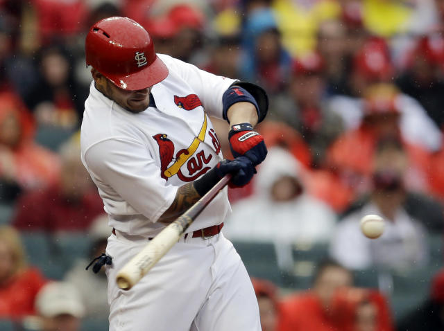 St. Louis Cardinals' Yadier Molina hits a three-run double during the first inning of a baseball game against the Cincinnati Reds, Monday, April 7, 2014, in St. Louis. (AP Photo/Jeff Roberson)