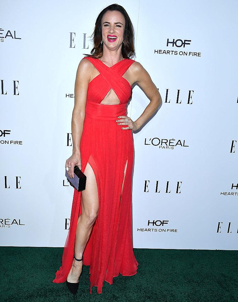 <p>Juliette Lewis showed some leg in this sexy, red Thai Nguyen Atelier gown. <i>(Photo by Steve Granitz/WireImage)</i> </p>