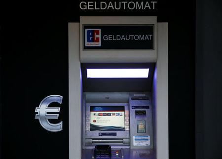 FILE PHOTO: An ATM machine is pictured with a euro sign next to it in Mainz, Germany, February 8, 2016. REUTERS/Kai Pfaffenbach/File Photo