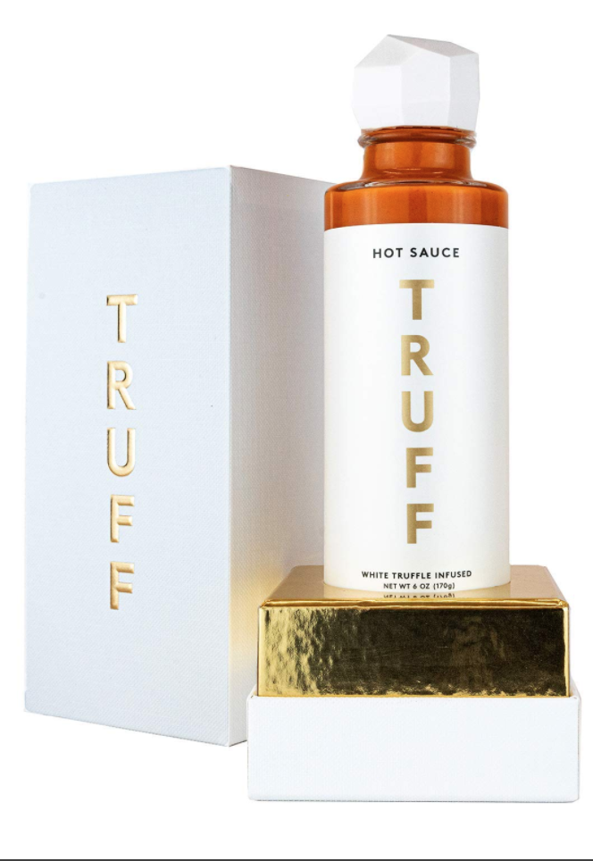 """<p><strong>TRUFF</strong></p><p>amazon.com</p><p><strong>$34.99</strong></p><p><a href=""""https://www.amazon.com/dp/B07XV8LVQK?tag=syn-yahoo-20&ascsubtag=%5Bartid%7C10072.g.33980079%5Bsrc%7Cyahoo-us"""" rel=""""nofollow noopener"""" target=""""_blank"""" data-ylk=""""slk:Shop Now"""" class=""""link rapid-noclick-resp"""">Shop Now</a></p><p>""""The packaging is cool, the hot sauce is sublime!"""" <a href=""""https://www.oprahmag.com/life/food/g29699970/oprah-favorite-things-2019-food-gifts/?slide=7"""" rel=""""nofollow noopener"""" target=""""_blank"""" data-ylk=""""slk:says Oprah"""" class=""""link rapid-noclick-resp"""">says Oprah</a>. """"I live for <a href=""""https://www.amazon.com/TRUFF-Gourmet-Peppers-Truffle-Experience/dp/B07HMJWCNL?tag=syn-yahoo-20&ascsubtag=%5Bartid%7C10072.g.33980079%5Bsrc%7Cyahoo-us"""" rel=""""nofollow noopener"""" target=""""_blank"""" data-ylk=""""slk:the black truffle version"""" class=""""link rapid-noclick-resp"""">the black truffle version</a>, but this white-truffle-infused limited release is slightly sweet, slightly exotic, and every bit as delicious. Put it on everything. Give it to everyone.""""</p>"""