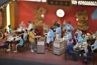 The miniature models are a striking recreation of the streets and landmarks of old Hong Kong