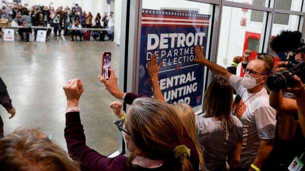 PHOTO: Supporters of President Donald Trump bang on the glass and chant slogans outside the room where absentee ballots for the 2020 general election are being counted at TCF Center on Nov. 4, 2020, in Detroit. (Jeff Kowalsky/AFP via Getty Images)