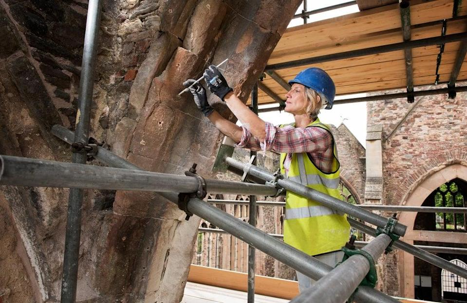 A building conservator works on the Church of St Peter in Bristol (James O. Davies/Historic England/PA) (PA Media)