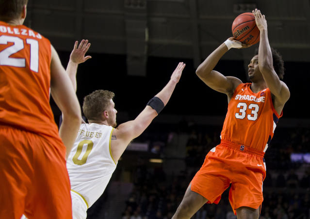 Syracuse's Elijah Hughes(33) shoots over Notre Dame's Rex Pflueger (0) during the second half of an NCAA college basketball game Wednesday, Jan. 22, 2020, in South Bend, Ind. Syracuse won 84-82. (AP Photo/Robert Franklin)
