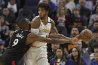 Toronto Raptors center Serge Ibaka (9) knocks the ball away from Golden State Warriors forward Marquese Chriss during the first half of an NBA basketball game in San Francisco, Thursday, March 5, 2020. (AP Photo/Jeff Chiu)