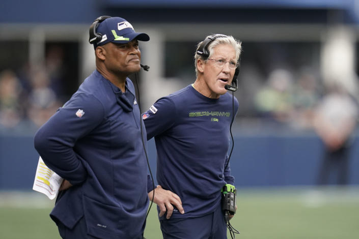 Seattle Seahawks head coach Pete Carroll, right, stands with defensive coordinator Ken Norton Jr., left, during the first half of an NFL football game against the Tennessee Titans, Sunday, Sept. 19, 2021, in Seattle. (AP Photo/Elaine Thompson)