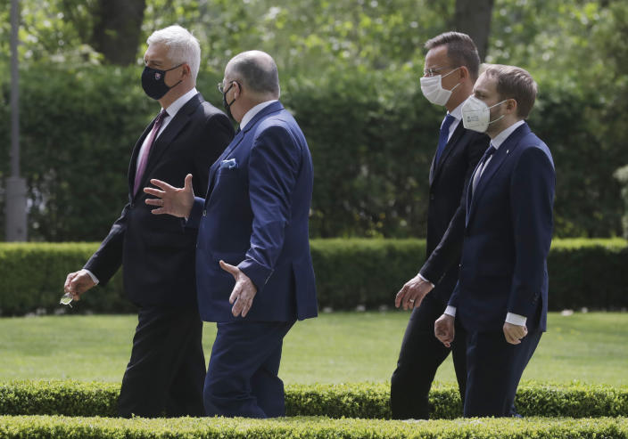 Slovak Foreign Minister Ivan Korcok,left,, Polish Foreign Minister Zbigniew Rau ,Hungarian Foreign Minister Peter Szijjarto and Czech Republic Foreign Minister Tomas Petricek ,right, walk after the foreign ministers of the Visegrad Group ,V4, meeting in Lodz, Poland, Friday, May 14, 2021.(AP Photo/Czarek Sokolowski)