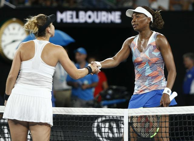 Tennis - Australian Open - Venus Williams of the U.S. v Belinda Bencic of Switzerland - Rod Laver Arena, Melbourne, Australia, January 15, 2018. Bencic and Williams shake hands after Bencic won their match. REUTERS/Thomas Peter TPX IMAGES OF THE DAY