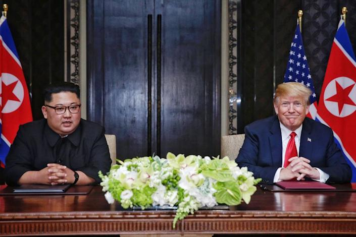 Kim Jong-un and Donald Trump sign their joint agreement (Picture: Getty)