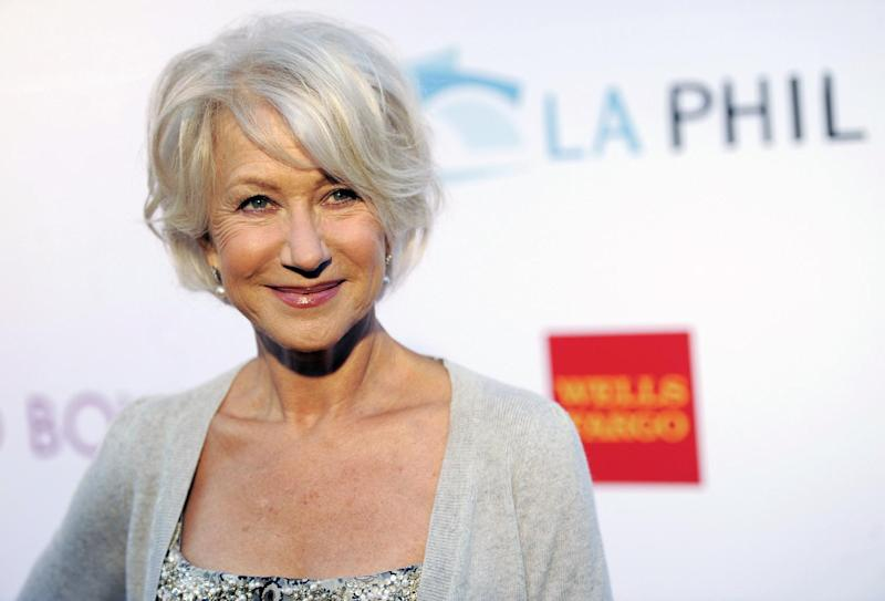 FILE - In this June 17, 2011 file photo, actress Helen Mirren poses at the opening of the 90th season of the Hollywood Bowl in Los Angeles. Gray heads have been popping up on runways and red carpets, on models and young celebrities for months. There's Lady Gaga and Kelly Osbourne _ via dye _ and Hollywood royalty like Oscar-winning British actress Helen Mirren. (AP Photo/Chris Pizzello, file)