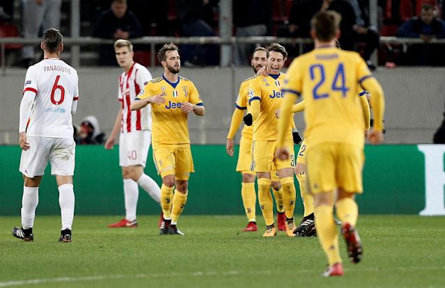 Soccer Football - Champions League - Olympiacos vs Juventus - Karaiskakis Stadium, Piraeus, Greece - December 5, 2017 Juventus' Federico Bernardeschi celebrates scoring their second goal with teammates REUTERS/Costas Baltas