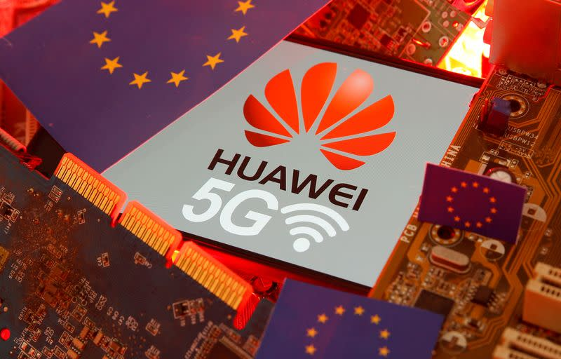 The EU flag and a smartphone with the Huawei and 5G network logo are seen on a PC motherboard in this illustration