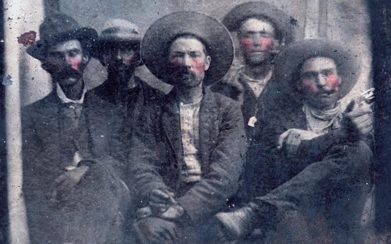 Billy the Kid (second from left) and Pat Garrett and his killer Pat Garrett (far right) together