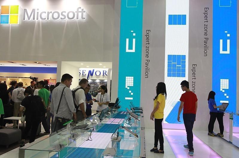 People visit the Microsoft booth during the 2014 Computex exhibition at the TWTC Nangang exhibition hall in Taipei