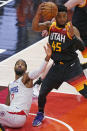 Los Angeles Clippers guard Paul George (13) reaches for the ball as Utah Jazz guard Donovan Mitchell (45) pulls down a rebound during the first half of Game 2 of a second-round NBA basketball playoff series Thursday, June 10, 2021, in Salt Lake City. (AP Photo/Rick Bowmer)