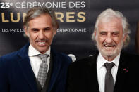 FILE - In this Feb. 5, 2018 file photo, French actor Jean-Paul Belmondo, right, and his son Paul Belmondo pose during a photocall prior to the 23rd Lumieres awards ceremony in Paris. French New Wave actor Jean-Paul Belmondo has died, according to his lawyer's office on Monday Sept. 6, 2021. (AP Photo/Francois Mori, File)